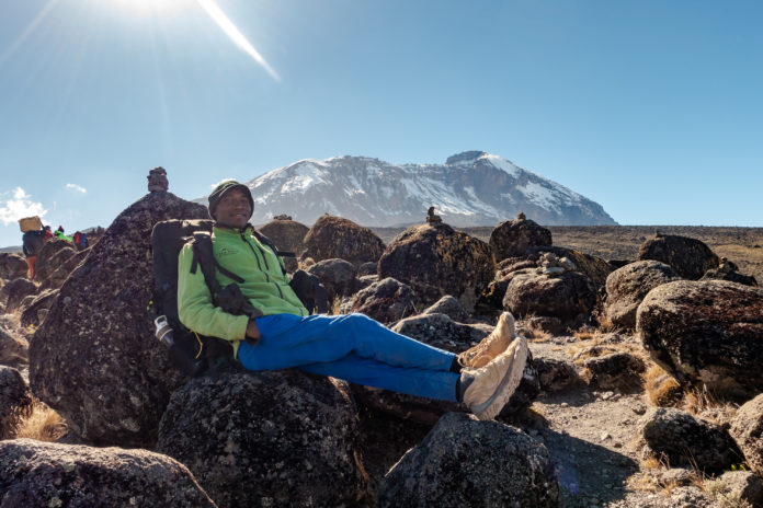 Unser Bergführer Tami bei einer kurzen Pause
